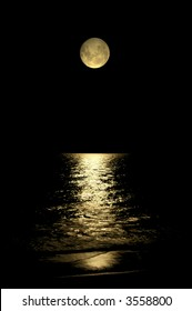 A beautiful moon glowing on the water of the ocean