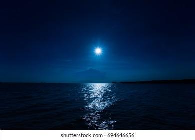 beautiful moon light over the sea in winter. Dark night