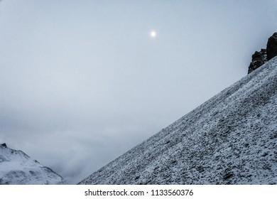Beautiful moon mountain landscape on the Thorong La pass on a cloudy day, Nepal.