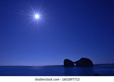 Beautiful Moonlight with silhouette of Engetsuto Island in Shirahama, Wakayama, Southern Japan