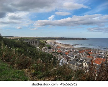 Beautiful Moray coastal landscape looking across the rooftops of Cullen and its viaduct.