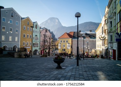 Beautiful morning cityscape with town square and old colorful traditional houses on a background of clear autumn sky in Kufstein city, Austria.