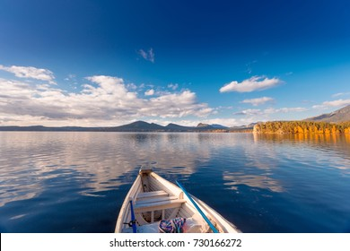Beautiful morning landscape. Colorful vintage boats on Borovoe lake at Burabay National park in Northern Kazakhstan.