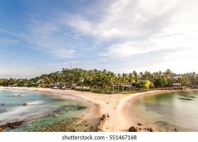 Beautiful morning landscape tropical beach. Mirissa Beach. Sri Lanka.