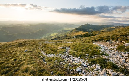 Beautiful morning light on hiking trail in the Alps. View over Vipava valley in late summer afternoon. Summer on Nanos mountain. Sunset over Vipava valley.