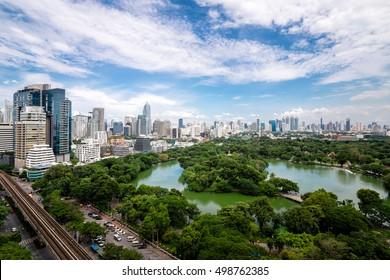 Beautiful morning period cityscape at Lumphini Park, Bangkok, Thailand. Lumphini Park (or Lumpini Park) is a park in Bangkok, Thailand. The sky is cloudy.