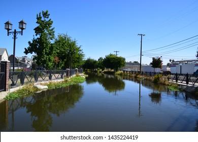 Beautiful morning reflection of Kern Island Canal at Mill Creek park, Bakersfield, CA.