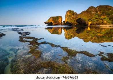 A beautiful morning reflection at Siung beach, listed as one of the beautiful beach in Jogjakarta, Indonesia. Soft focus due to long exposure.