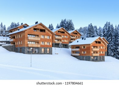 Beautiful morning sunrise view of apartment buildings with fresh powder snow in the mountains of the Brandnertal in the Alps in Vorarlberg, Austria, in winter