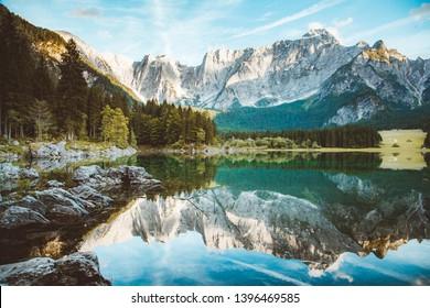 Beautiful morning view of famous Superior Fusine Lake with Mount Mangart in the background at sunrise, Tarvisio, Udine province, Friuli Venezia Giulia, Italy