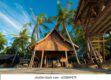 Beautiful morning view of a resort on white sandy beach with blue sky and coconut tree in Mantanani Island, Sabah, Malaysia