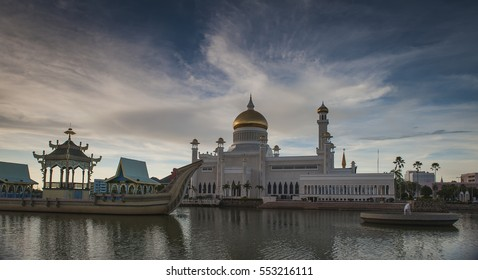 Beautiful Mosque in Bandar Seri Begawan floating on lake with traditional ship side and soft cloud bluesky background  Brunei Darussalam, Asia.