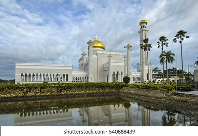 Beautiful Mosque building on lake in Bandar Seri Begawan with cloud blue sky background Brunei Darussalam.