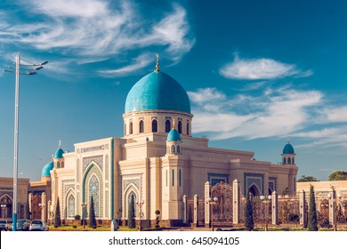 Beautiful Mosque (Islamic temple) at sunset over blue sky
