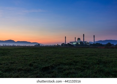 Beautiful mosque on green field with sunrise,Songkhla Thailand