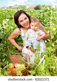 Beautiful mother ans baby son smiling portrait outdoors