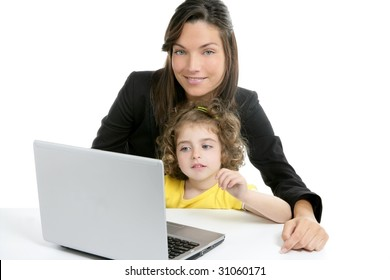 Beautiful mother and daughter with laptop computer on white background