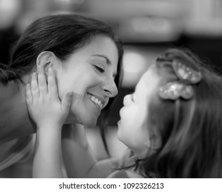 Beautiful mother and daughter share a tender moment black and white
