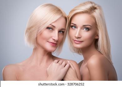 Beautiful mother and daughter in studio