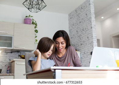 Beautiful Mother and Daughter working Homework