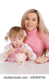 A beautiful mother with her daughter with moneybox on a white background