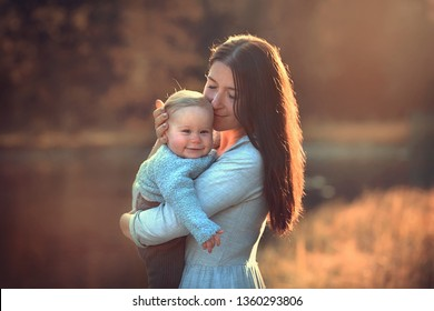 Beautiful mother with her little cute daughter near Lake Anterselva in Italy. Image with selective focus and toning