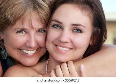 beautiful mother and pretty daughter embrace.