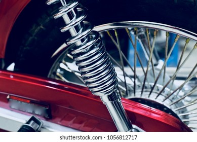 Beautiful motorbike suspension parts with tyre background unique stock photo