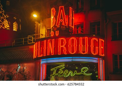 Beautiful Moulin Rouge cabaret sign in Paris, France. Red letters written Bar Moulin Rouge.