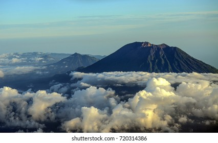 Beautiful mount Agung and the surrounding cloud as seen from an airplane window.