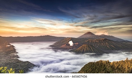 Beautiful Mount Bromo landscape view in sunrise misty morning with beautiful clouds and Semeru Volcano background. Taken from Penanjakan-1 view point