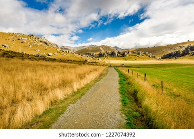 Beautiful mountain green and yellow landscape with huge boulders and rock outcrops at Kura Tawhiti, Castle Hill Conservation Area, on The Great Alpine Highway on South Island, Canterbury, New Zealand.
