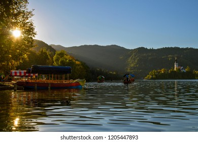Beautiful mountain lake Bled .Tourist boat on the on Lake Ble. Pilgrimage Church of the Assumption of Maria situated on an island .  Slovenia, Europe. European travel.