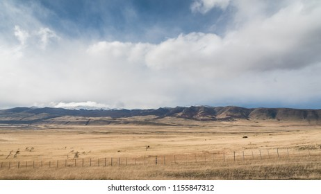 Beautiful mountain landscape with cloudy bluesky with dryland foreground. Typical weather of Argentina, Patagonia