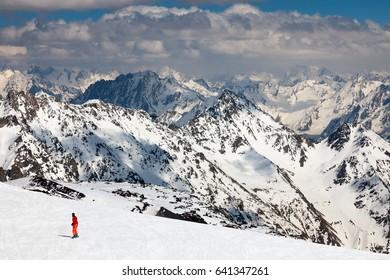 A beautiful mountain landscape. Mount Elbrus, view from the ski station of Gara-Bashi (3.840 m) to the Caucasus mountain range and ski slopes.
