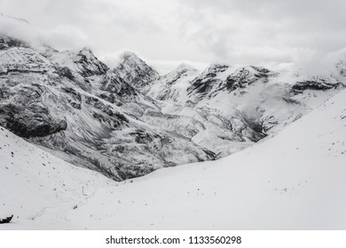 Beautiful mountain landscape on the snow-covered Thorong La pass on a cloudy day, Nepal.