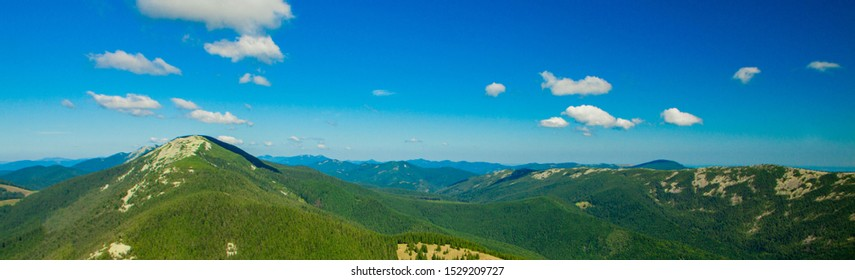 Beautiful mountain landscape, with mountain peaks covered with forest and a cloudy sky. Ukraine mountains, Europe.