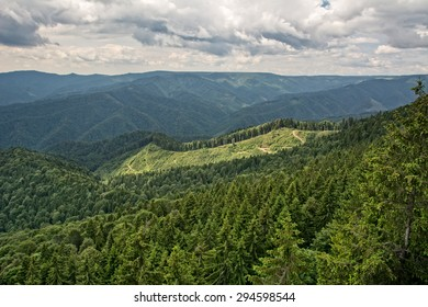 Beautiful mountain landscape, with mountain peaks covered with forest and a cloudy sky. Carpathian mountains, Europe