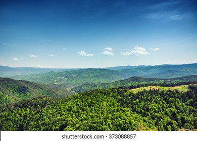 Beautiful mountain landscape, with mountain peaks covered with forest and a cloudy sky. Bulgarian mountains, Europe