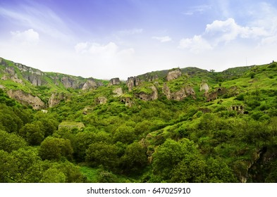 Beautiful mountain landscape, with mountain peaks covered with forest and a cloudy sky. Armenian and Georgian mountains, Caucasian mountain range