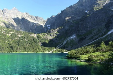 Beautiful mountain landscape print. Beautiful clear blue lake in the mountains.