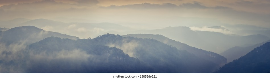 Beautiful mountain landscape at rainy day, fog over the hills. Dalat, Vietnam. Panorama