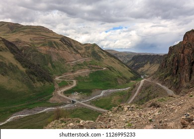 A beautiful mountain landscape. The region of Elbrus, Karachay-Cherkessia, Russia. The gorge of the Malka River, the Gyly-Su tract. The place of exit of curative mineral springs and volcanic rocks.