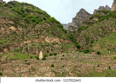 A beautiful mountain landscape. Russian Federation, Northern Caucasus, Karachay-Cherkessia, Verkhny Chegem village, watchtower on the mountainside.
