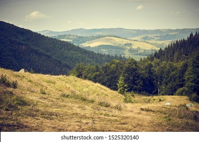 Beautiful mountain landscape. The slopes of the Carpathian mountains in the summer. Glade of hippies with lonely tents.