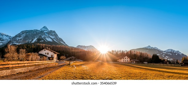 Beautiful mountain landscape with a small village, called Ehrwald, located at the foot of the Austrian Alps, under a clear blue sky and a gorgeous sun.
