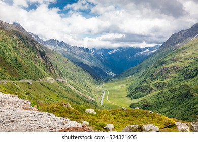 beautiful mountain landscape in summer time, road through the mountains, Alps, Switzerland