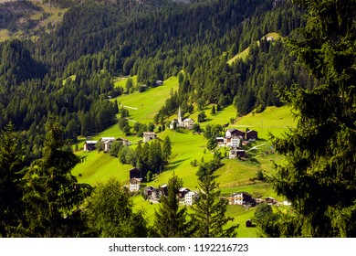 beautiful mountain landscape. view of a small Italian village located on the slope of the mountains. Dolomites, Italy