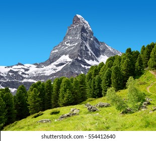Beautiful mountain landscape with views of the Matterhorn peak in Pennine alps, Switzerland.