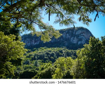 A beautiful mountain, Mount Ninderry in the Sunshine Coast Hinterland, Queensland, Australia, with lush greenery against a stunning clear blue sky